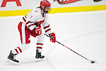 Wisconsin Badgers Kelly Jaminski (25) handles the puck against Team Japan during a women's hockey exhibition in Madison, Wisconsin, on September 23, 2013. The Badgers won 3-0. (Photo by David Stluka)