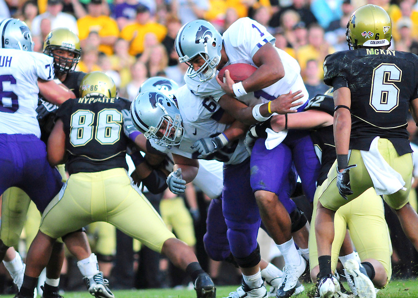18 October 08: Kansas State quarterback Josh Freeman looks for a hole as he rushes against Colorado. The Colorado Buffaloes defeated the Kansas State Wildcats 14-13 at Folsom Field in Boulder, Colorado.