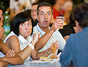 SAGRA DEL &quot;PESCE E PATATE&quot; 2011, BARGA, ITALY<br /> <br /> VISITORS ENJOY THEIR FISH AND CHIPS.