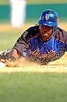 15 March 2006: Lastings Milledge, outfielder for the New York Mets, dives safely back to first during a Spring Training game against the Washington Nationals. The Mets defeated the Nationals 8-5 at Space Coast Stadium, in Viera, Florida...Mandatory Photo Credit: Ed Wolfstein..