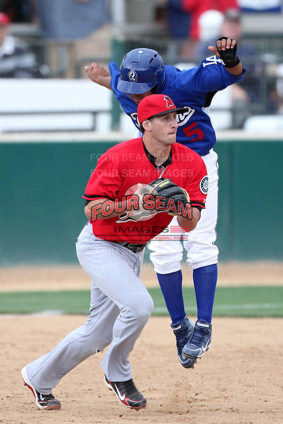 Vinnie Catricala #23 of the High Desert Mavericks looks to second base after tagging out Rafael Ynoa of the Rancho Cucamonga Quakes at The Epicenter in Rancho Cucamonga,California on May 8, 2011. Photo by Larry Goren/Four Seam Images