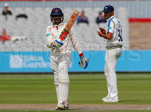 May 21st 2017, Emirates Old Trafford, Manchester, England; Specsavers County Championship Division One; Day Three; Lancashire versus Yorkshire; Shivnarine Chanderpaul of Lancashire acknowledges the crowd's applause as he reaches his half century, as Azeem Rafiq of Yorkshire looks on