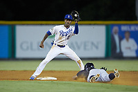 Burlington Royals shortstop Maikel Garcia (2) fields a throw as Gustavo Campero (24) of the Pulaski Yankees slides head first into second base at Burlington Athletic Stadium on August 25, 2019 in Burlington, North Carolina. The Yankees defeated the Royals 3-0. (Brian Westerholt/Four Seam Images)