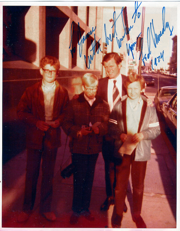 "The photo was taken outside KGO TV Studio in San Francisco, May 16, 1971. The kids are, from left, Dan Swanson (now a partner at Gibson Dunne and Crutcher in Los Angeles); Roger Mahan (senior staff member of the House Budget Committee), and I'm the kid(Jim Rogan) in the blue jacket, brown pants, yellow sweater, and some other similarly colorful pair of socks.. I assume Roll Call won't take this picture and use it for any purpose other than to accompany the story Zach is doing, or to use it for the ""In the Attic"" section as you discussed!"