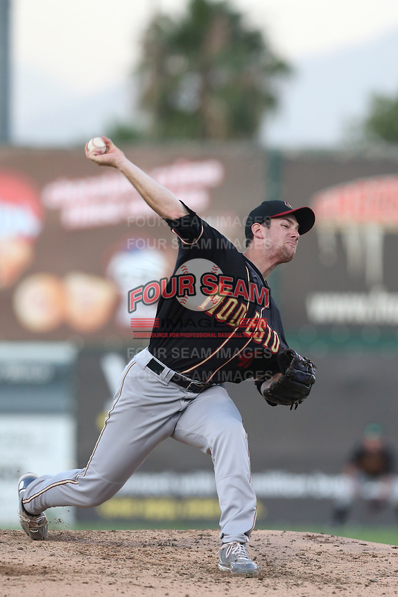 Devin Burke #41 of the Modesto Nuts pitches against the Inland Empire 66ers at San Manuel Stadium on May 28, 2014 in San Bernardino, California. Modesto defeated Inland Empire, 3-2. (Larry Goren/Four Seam Images)