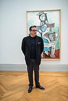 """Die Ausstellung """"Picasso. Das spaete Werk"""" wird vom 9. Maerz bis 16. Juni 2019 im Potsdamer Museum Barberini gezeigt.  Alle Leihgaben, Gemaelde, Keramiken, Skulpturen und Graphiken von Pablo Picasso (1881–1973), stammen aus der Sammlung Jacqueline Picasso (1927–1986).<br /> In der von Gastkurator Bernardo Laniado-Romero getroffenen Auswahl befinden sich zahlreiche Werke, die erstmalig in Deutschland gezeigt werden sowie einige, die zum ersten Mal in einem Museum praesentiert werden.<br /> Im Bild: Bernardo Laniado-Romero, Kurator der Ausstellung vor dem Gemaelde """"Frau mit Hund"""", Oel auf Leinwand, vom Mai 1959 bis Januar 1960.<br /> 7.3.2019, Potsdam<br /> Copyright: Christian-Ditsch.de<br /> [Inhaltsveraendernde Manipulation des Fotos nur nach ausdruecklicher Genehmigung des Fotografen. Vereinbarungen ueber Abtretung von Persoenlichkeitsrechten/Model Release der abgebildeten Person/Personen liegen nicht vor. NO MODEL RELEASE! Nur fuer Redaktionelle Zwecke. Don't publish without copyright Christian-Ditsch.de, Veroeffentlichung nur mit Fotografennennung, sowie gegen Honorar, MwSt. und Beleg. Konto: I N G - D i B a, IBAN DE58500105175400192269, BIC INGDDEFFXXX, Kontakt: post@christian-ditsch.de<br /> Bei der Bearbeitung der Dateiinformationen darf die Urheberkennzeichnung in den EXIF- und  IPTC-Daten nicht entfernt werden, diese sind in digitalen Medien nach §95c UrhG rechtlich geschuetzt. Der Urhebervermerk wird gemaess §13 UrhG verlangt.]"""