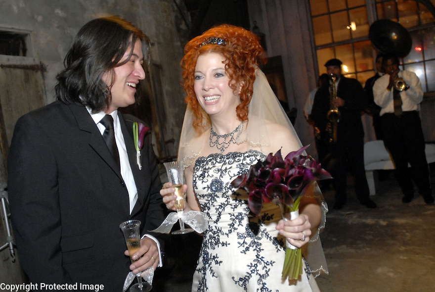 Chris Lee and  Sean Yseult share a toast in the courtyard after their wedding in New Orleans, Saturday, Jan. 12, 2008.