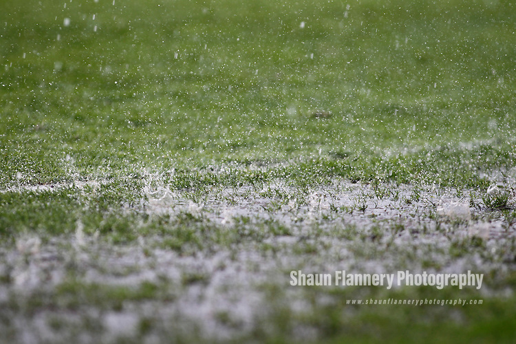 Pix: Shaun Flannery/shaunflanneryphotography.com...COPYRIGHT PICTURE>>SHAUN FLANNERY>01302-570814>>07778315553>>..223rd April 2011..............Rain bounces off grass during a torrential downpour.