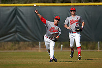 Illinois State Redbirds right fielder Jared Hendren (19) throws the ball in as Sean Beesley (29) backs up the play during a game against the Ohio State Buckeyes on March 5, 2016 at North Charlotte Regional Park in Port Charlotte, Florida.  Illinois State defeated Ohio State 5-4.  (Mike Janes/Four Seam Images)