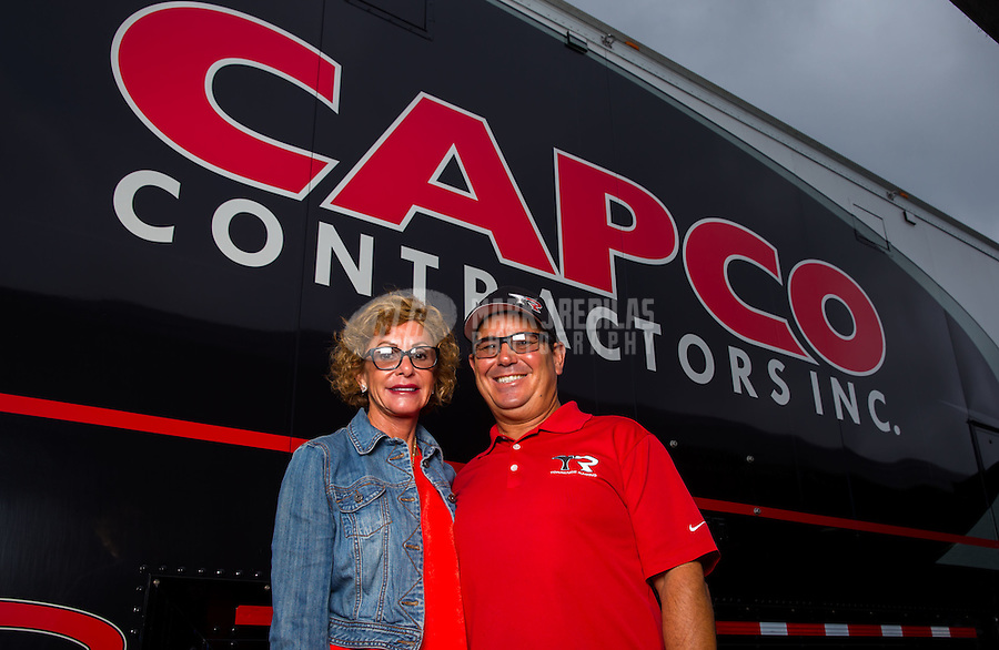 Sept. 1, 2014; Clermont, IN, USA; NHRA  top fuel dragster driver Billy Torrence poses for a portrait with wife Kay Torrence during the US Nationals at Lucas Oil Raceway. Mandatory Credit: Mark J. Rebilas-USA TODAY Sports