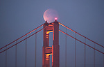 Early risers on the west coast got to see a total lunar eclipse Saturday morning 12/10 as it set over the south tower of the Golden Gate Bridge in San Francisco, California. ..