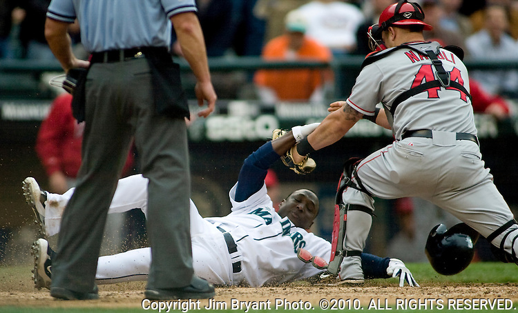 Los Angeles Angels catcher Mike Napoli (R) tags out Seattle Mariners'  Yuniesky Betancourt (C) after he tried to score from first base on a single hit by Ichiro Suzuki to center field in the sixth inning at Safeco Field in Seattle June 4, 2008.  The Angels beat the Mariners 5-4.     Jim Bryant Photo. ©2010. All Rights Reserved