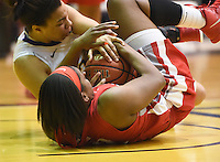 Hartford senior Cherelle Moore fights for a loose ball with Albany's Tiana-Jo Carter.  Albany claimed the America East Championship for the forth year in a row with a 84-75 win over the Hawks.  Steve McLaughlin / Special to The Courant