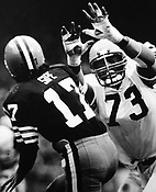 Cleveland Browns Brian Sipe unleashes a pass under heavy pressure from Cincinnati's Eddie Edwards during the game in Cleveland on November 23, 1980. The Browns won the pivotal game, putting them ahead of rival Pittsburgh. Associated Press/Ernie Mastroianni