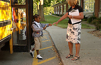 A teacher reaches out to a student for the first day of school.