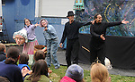 """Members of Arm-of-the-Sea Theater, Laura Rock Kopczak, Anna Hoffner, Patrick Wadden and Soyal Smalls, acknowledging their off stage member Eli Winogard, at the end of the presentation of their new play """"DIRT"""" that tells the story of how Garlic came to the area, at the 27th Annual Hudson Valley Garlic Festival, held in Cantine Memorial Field, in Saugerties, NY, on Saturday, October 1, 2016. Photo by Jim Peppler; Copyright Jim Peppler 2016."""