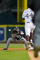 Jess Buenger #14 of the Rice Owls waits for the ball as Luke Anders #44 of the Texas A&M Aggies hustles down the first base line at the 2009 Houston College Classic at Minute Maid Park February 28, 2009 in Houston, TX.  The Owls defeated the Aggies 2-0. (Photo by Brian Westerholt / Four Seam Images)