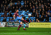 Fleetwood Town's forward Devante Cole (44) beats Scunthorpe Utd's defender Rory McArdle (23) to the ball during the Sky Bet League 1 match between Scunthorpe United and Fleetwood Town at Glanford Park, Scunthorpe, England on 17 October 2017. Photo by Stephen Buckley/PRiME Media Images