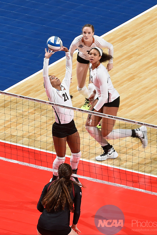COLUMBUS, OH - DECEMBER 17:  Chloe Collins (21) of the University of Texas sets the ball against Stanford University during the Division I Women's Volleyball Championship held at Nationwide Arena on December 17, 2016 in Columbus, Ohio.  Stanford defeated Texas 3-1 to win the national title. (Photo by Jamie Schwaberow/NCAA Photos via Getty Images)