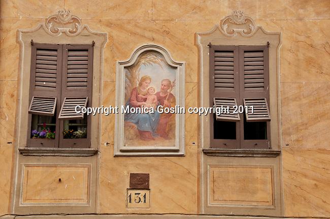 A fresco between two windows on a house in Gera Lario, a town on Lake Como, Italy