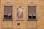 A fresco between two windows on a house in Gera Lario, a town on Lake Como, Italy