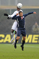 Akron Zips Kofi Sarkodie (4) heads the ball over Virginia Cavaliers Neil Barlow (7) during the finals of the 2009 NCAA Men's College Cup at WakeMed Soccer Park in Cary, NC on December 13, 2009.
