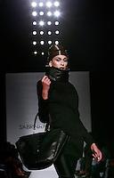 Una modella veste una creazione della collezione Autunno Inverno 2014/2015 di Sabrina Persechino durante la rassegna Altaroma, a Roma, 14 luglio 2014.<br /> A model wears a creation by Sabrina Persechino Fall Winter 2014/2015 collection at the Altaroma fashion week in Rome, 14 July 2014.<br /> UPDATE IMAGES PRESS/Isabella Bonotto