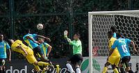 BOGOTA - COLOMBIA -12 -03-2016: Jonathan Avila (Izq.) jugador de Alianza Petrolera, anota  gol a Diego Novoa (Cent.) portero de La Equidad, durante partido entre La Equidad y Alianza Petrolera, por la fecha 9 de la Liga Aguila I-2016, jugado en el estadio Metropolitano de Techo de la ciudad de Bogota. / Jonathan Avila (L), player of Alianza Petrolera, scored goal to Diego Novoa (C) goalkeeper of La Equidad, during a match La Equidad and Alianza Petrolera, for the  date 9 of the Liga Aguila I-2016 at the Metropolitano de Techo Stadium in Bogota city, Photo: VizzorImage  / Luis Ramirez / Staff.