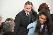 David Cameron MP greets local Conservative Association members at a Conservative Party general election press conference at Kingsmead School, Enfield, London.