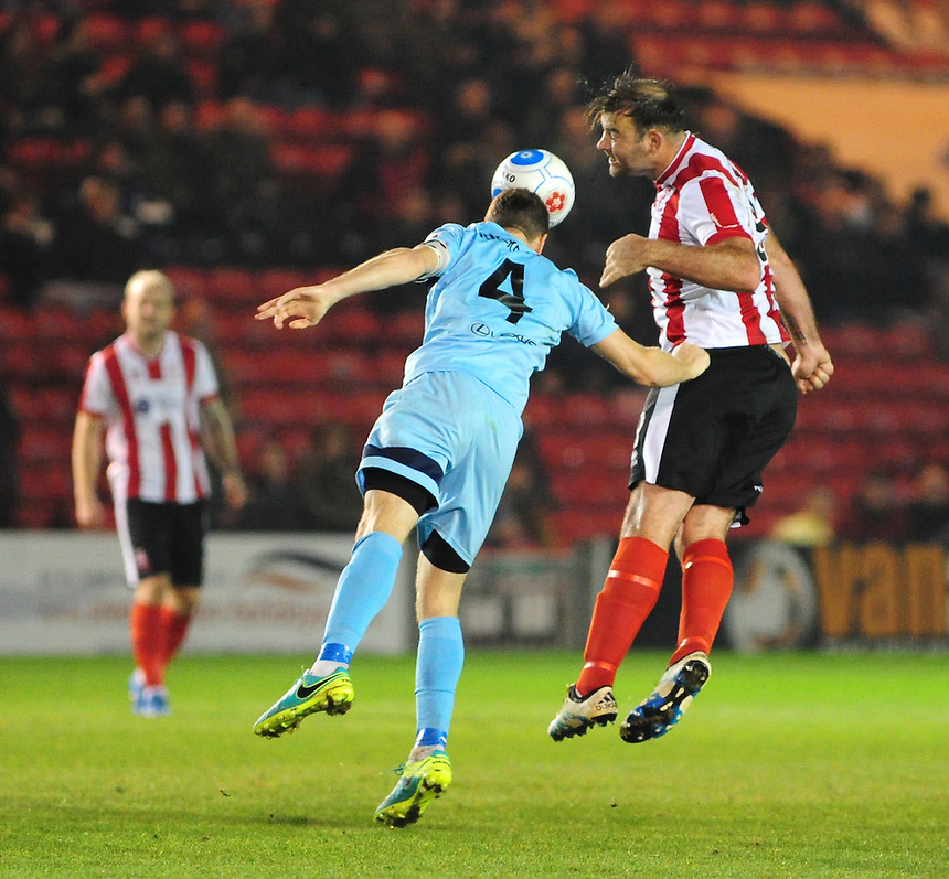 Lincoln City's Matt Rhead vies for possession with Boreham Wood's Mark Ricketts<br /> <br /> Photographer Andrew Vaughan/CameraSport<br /> <br /> Vanarama National League - Lincoln City v Boreham Wood - Tuesday 25th October 2016 - Sincil Bank - Lincoln<br /> <br /> World Copyright &copy; 2016 CameraSport. All rights reserved. 43 Linden Ave. Countesthorpe. Leicester. England. LE8 5PG - Tel: +44 (0) 116 277 4147 - admin@camerasport.com - www.camerasport.com