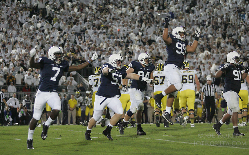 State College, PA - 10/12/2013:  The PSU defenders celebrate a missed field goal in OT.  Penn State defeated Michigan by a score of 43-40 in 4 overtimes on Saturday, October 12, 2013, at Beaver Stadium.<br /> <br /> Photos by Joe Rokita / JoeRokita.com