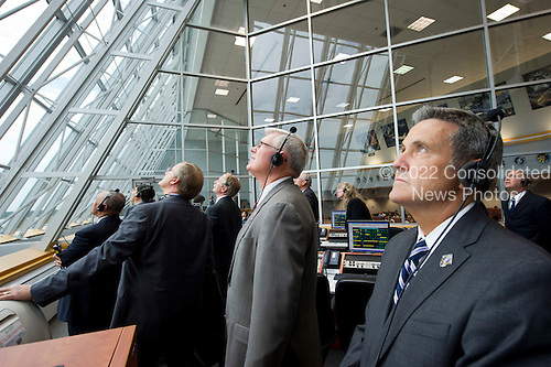NASA Kennedy Space Center Director Bob Cabana, right, and other management look on from Firing Room Four of the Launch Control Center (LCC) as space shuttle Atlantis launches from pad 39A on Friday, July 8, 2011, in Cape Canaveral, Florida. The launch of Atlantis, STS-135, is the final flight of the shuttle program, a 12-day mission to the International Space Station. .Mandatory Credit: Bill Ingalls / NASA via CNP