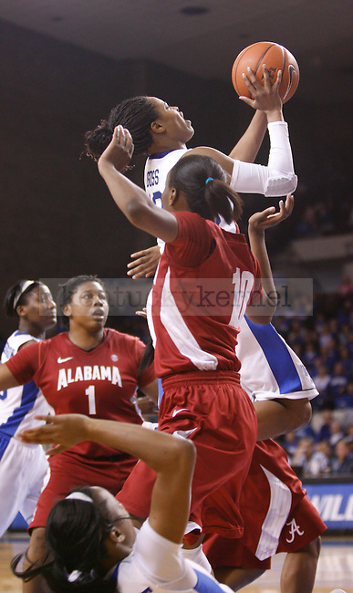 UK guard Bria Goss drives through 2 Alabama defenders to shoot the ball during the second half of the UK Women's basketball game against Alabama on 1/29/12 at Memorial Coliseum in Lexington, Ky. Photo by Quianna Lige | Staff