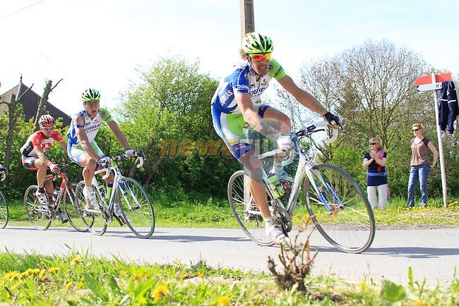 Daniel Oss (ITA) Liquigas-Cannondale leads a group of riders race through the village of Ennevelin during the 109th edition of the Paris-Roubaix cycle race, 10th April 2011 (Photo by Eoin Clarke/NEWSFILE)