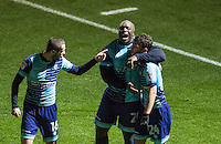 Adebayo Akinfenwa of Wycombe Wanderers & Michael Harriman of Wycombe Wanderers celebrate with goalscorer Scott Kashket of Wycombe Wanderers as he makes it 2 0  during the Sky Bet League 2 match between Wycombe Wanderers and Hartlepool United at Adams Park, High Wycombe, England on 26 November 2016. Photo by Kevin Prescod / PRiME Media Images.