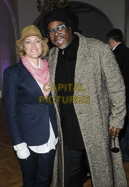 Cerys Matthews & Courtney Pine.attended the Jazz FM Awards 2013, One Marylebone, Marylebone Rd., London, England, 31st January 2013..half length pink scarf blue navy jacket  suit black  brown beige glass drink glasses black hat tweed brown jacket polo neck goatee beard facial hair .CAP/CAN.©Can Nguyen/Capital Pictures.