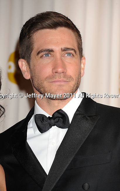 HOLLYWOOD, CA - FEBRUARY 27: Jake Gyllenhaal poses in the press room during the 83rd Annual Academy Awards held at the Kodak Theatre on February 27, 2011 in Hollywood, California.