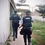 Patrol officers Luciana Montanari, 32, right, and Carla Bonn, 33, left. <br /> Rapid Response Team<br /> Pacifying Police Unit<br /> Complexo do Caju, Rio de Janeiro, Brazil