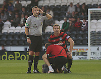 Martyn Campbell gets treatment before being substituted in the St Mirren v Ayr United Scottish Communities League Cup match played at St Mirren Park, Paisley on 29.8.12.