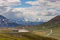 Tour bus travels along the Denali Park road at Stoney Dome, Denali National Park, Interior, Alaska.
