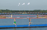 24 JUL 2014 - GLASGOW, GBR - Aileen Reid (NIR) (left) from Northern Ireland leads Nicky Samuels (NZL) (right) from New Zealand from the swim during the elite women's 2014 Commonwealth Games triathlon in Strathclyde Country Park, in Glasgow, Scotland (PHOTO COPYRIGHT &copy; 2014 NIGEL FARROW, ALL RIGHTS RESERVED)<br /> *******************************<br /> COMMONWEALTH GAMES <br /> FEDERATION USAGE <br /> RULES APPLY<br /> *******************************
