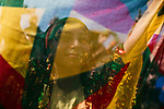A woman holds up a sheer scarf the colors of the Kurdish flag--green, yellow, and red--while dancing at Newroz, the Kurdish New Year celebration, in Viranşehir, Turkey, March 18, 2015. Newroz, or Nowruz, is an ancient holiday celebrated by a multitude of ethnic groups across Iran, Central Asia, and the Caucuses, and ushers in the first day of Spring, March 21. For Kurds, Newroz is a means of political and cultural expression, featuring Kurdish politicians, activists, and musicians, and has become a manifestation of Kurdish identity. In Turkey, the celebrations begin a few days before the Vernal Equinox, culminating in a huge gathering in the heart of Turkey's Kurdish population, the southeastern city of Diyarbakir. This year, PKK founder Abdullah Öcalan, who despite serving a life sentence for treason still enjoys widespread influence among Kurds, sent a letter that was read at Newroz in Diyarbakir, calling for an end to the PKK's armed struggle against the Turkish state.