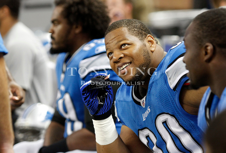 Detroit Lions defensive tackle Ndamukong Suh (90) sits on the bench at the start of a preseason NFL football game with the Detroit Lions Buffalo Bills, Thursday,  Sept. 2, 2010, in Detroit. (AP Photo/Tony Ding)