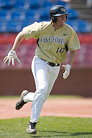 Shane Kroker #10 of the Wake Forest Demon Deacons takes a wide turn to round first base at Wake Forest Baseball Park April 11, 2009 in Winston-Salem, NC. (Photo by Brian Westerholt / Four Seam Images)
