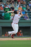 First baseman Nick Longhi (21) of the Greenville Drive bats in a game against the Greensboro Grasshoppers on Tuesday, August 25, 2015, at Fluor Field at the West End in Greenville, South Carolina. Longhi is the No. 27 prospect of the Boston Red Sox, according to Baseball America. Greensboro won, 3-2. (Tom Priddy/Four Seam Images)
