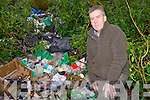 Killarney National Park conservation ranger Peter O'Toole pictured at the rubbish that was founded dumped near the back entrance of Dinis in Killarney on Wednesday.