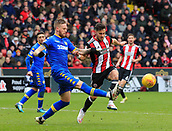 10th February 2018, Bramall Lane, Sheffield, England; EFL Championship football, Sheffield United versus Leeds United; Pontus Jansson of Leeds United clears the ball upfield under pressure from George Baldock of Sheffield United
