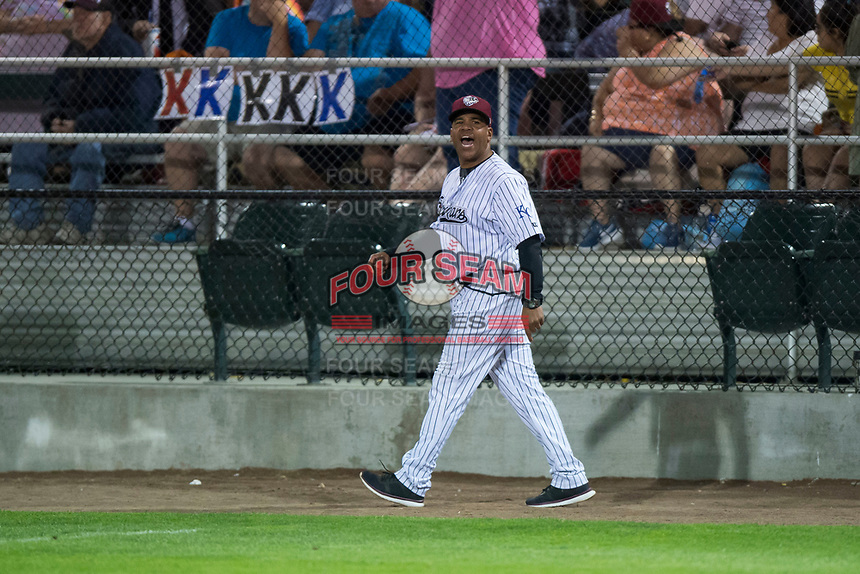 Idaho Falls Chukars manager Omar Ramirez (11) voices his discontent with home plate umpire Ethan McCranie (not pictured) after being ejected during a Pioneer League game against the Great Falls Voyagers at Melaleuca Field on August 18, 2018 in Idaho Falls, Idaho. The Idaho Falls Chukars defeated the Great Falls Voyagers by a score of 6-5. (Zachary Lucy/Four Seam Images)