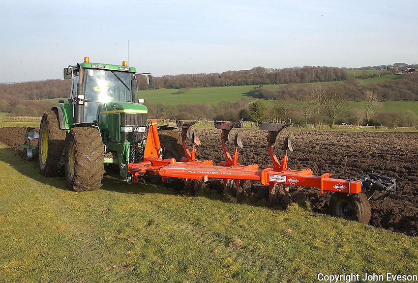 With a Kuhn 3 furrow reversible plough in front and a Dowdswell 5 furrow behind, Scott Hall, of K. Hall and Sons,  makes short work of an 8 acre field at the rate of 12 foot per pass. The two year grass ley is to planted with Blaze fodder beet to supply winter feed for the 240 suckler  cows at Halstead Farm, Thurstonland, Huddersfield, West Yorkshire. The ploughing outfit will really come into its own  in the larger arable fields on the 900 acre holding.