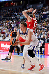 Real Madrid's Luka Doncic and Crvena Zvezda Mts Belgrade's Marko Simonovic during Turkish Airlines Euroleague match between Real Madrid and Crvena Zvezda Mts Belgrade at Wizink Center in Madrid, Spain. March 10, 2017. (ALTERPHOTOS/BorjaB.Hojas)